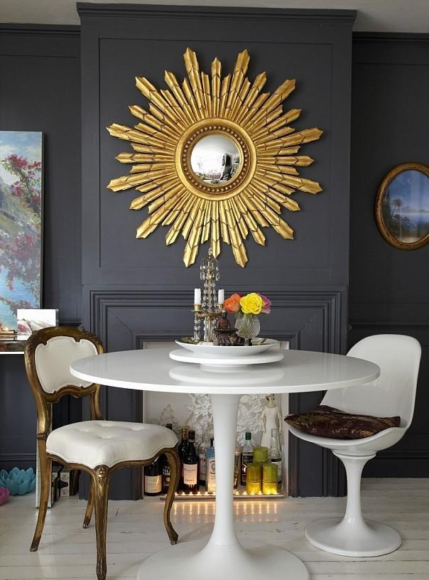 amazing-decorative-mirror-as-bright-sun-on-dark-wall-faced-fashionable-chair-and-round-white-top-coffee-table